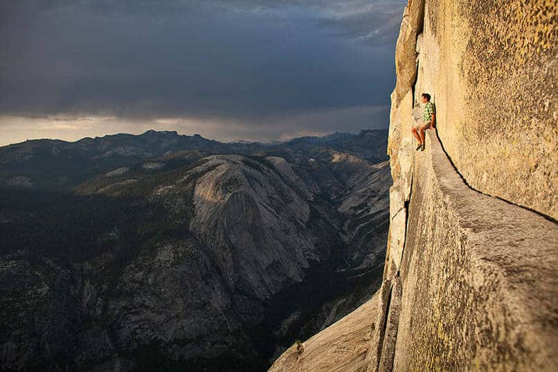 18. Alex Honnold, one of the world's most daring free-climbers, resting in the middle of a climb.