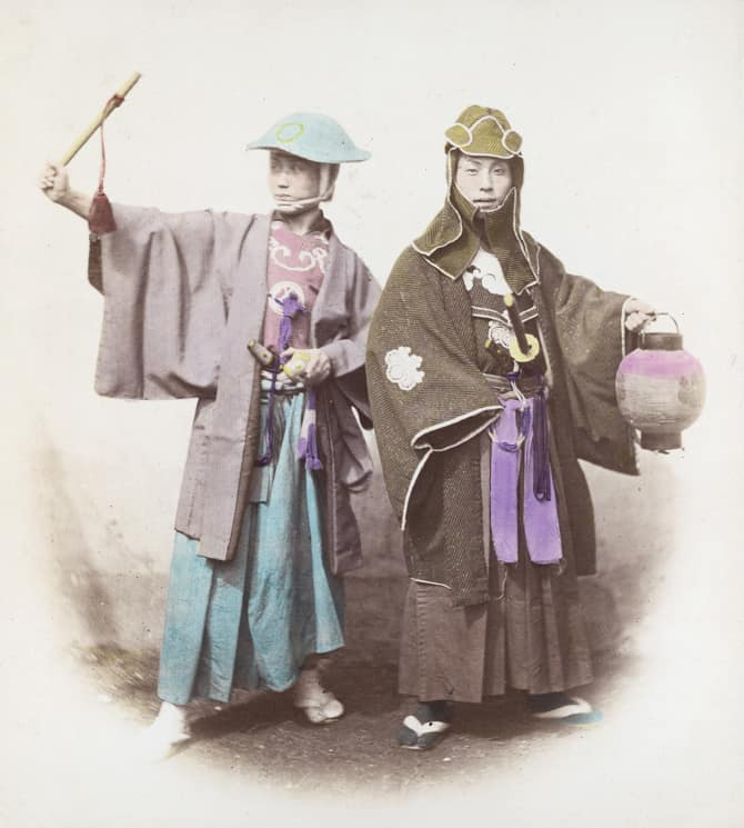 Two Japanese samurai in fire dress, circa 1865. The one on the left wears a jingasa hat, and the one on the right wears the traditional indigo tabi socks of the samurai firefighter. (Photo by Felice Beato/Hulton Archive/Getty Images)