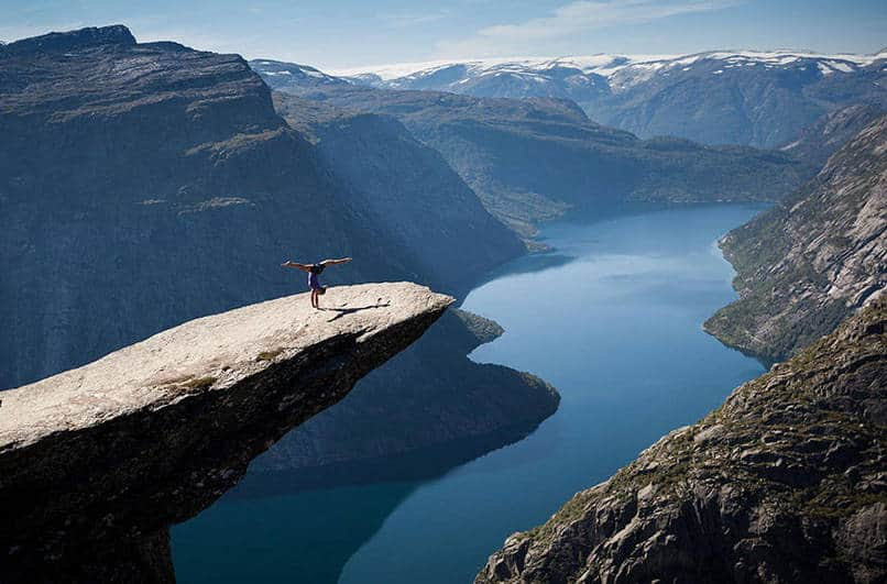 5. Doing some yoga on Norway's Trolltunga.