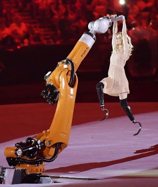 Amy Purdy performing with a giant robotic arm