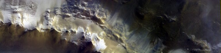 Part of the rim of the crater captured by the Colour and Stereo Surface Imaging System (CaSSIS) on Mars Express.