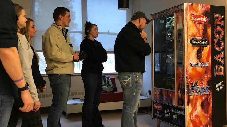 Fans of bacon lining up to order from the bacon vending machine